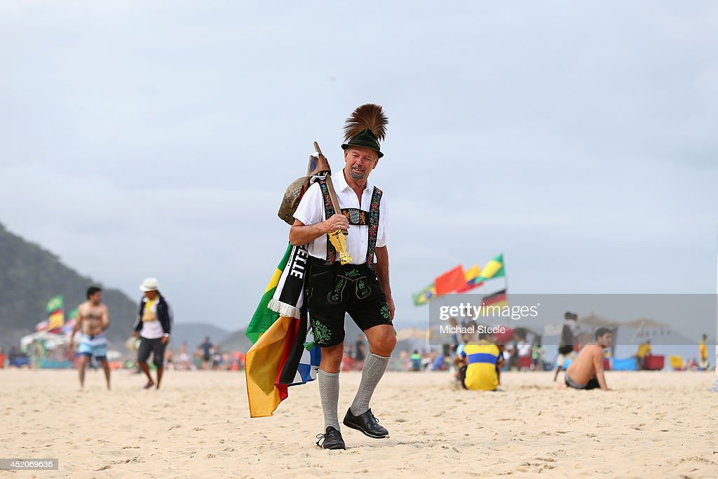 A traditionally dressed Bavarian German supporter walks along Copacabana Beach ahead of the 2014 FIFA World Cup Brazil Final match on July 12, 2014 in Rio de Janeiro, Brazil.