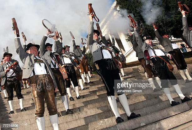 Traditionally dressed Bavarian riflemen fire a shot with their oneshot handguns during the last day of Oktoberfest beer festival on October 7 2007 in...