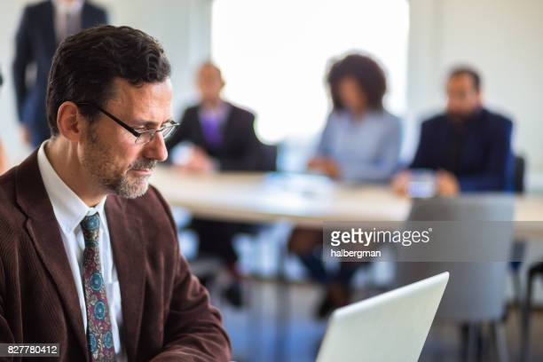 Traditionally Dressed Businessman in Cool Modern Startup Office