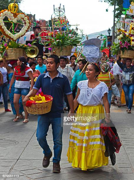A Traditionally Dressed Couple In A Parade During The July Guelaguetza Festival Oaxaca Mexico