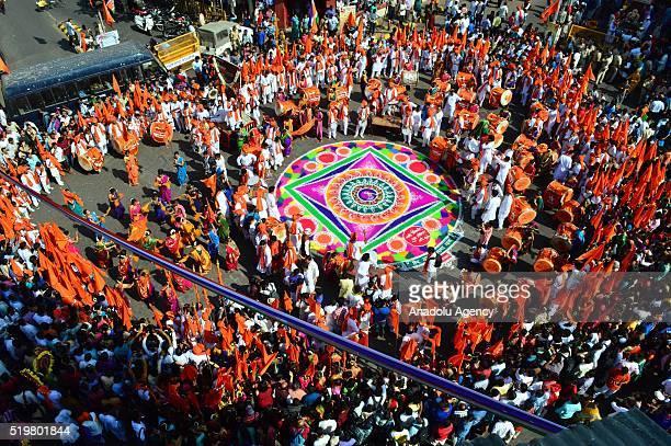 Traditionally dressed Indian people celebrate the Gudi Padwa Maharashtrian's New Year in Mumbai India 08 April 2016 Gudi Padwa is the Hindu festival...