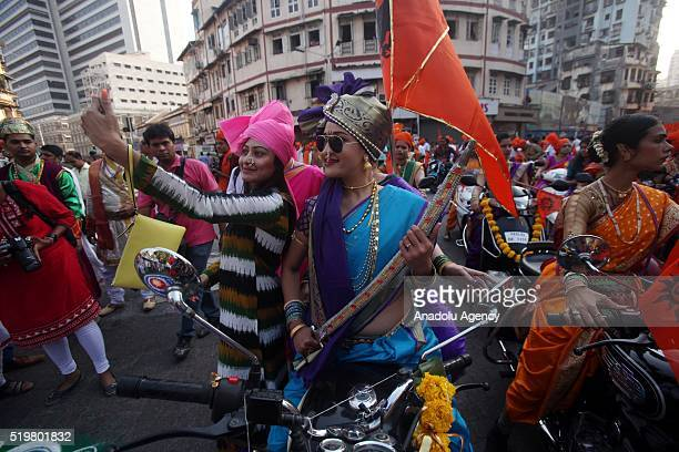 Traditionally dressed Indian people take selfie as they celebrate the Gudi Padwa Maharashtrian's New Year in Mumbai India 08 April 2016 Gudi Padwa is...