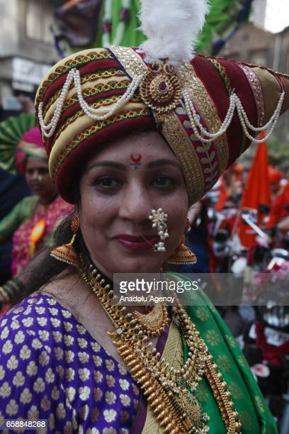 Traditionally dressed Indian woman celebrates the Gudi Padwa, Maharashtrian's New Year in Mumbai, India on March 28, 2017. Gudi Padwa is the Hindu...
