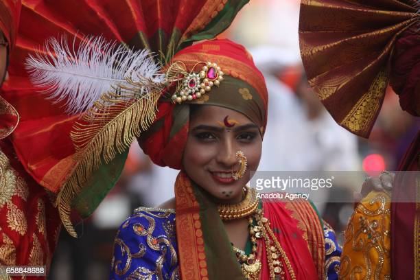 Traditionally dressed Indian woman celebrates the Gudi Padwa, Maharashtrian's New Year in Mumbai, India on March 28, 2017. Gudi Padwa is the Hindu...