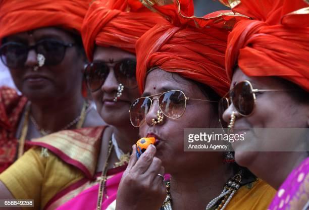 Traditionally dressed Indian women celebrate the Gudi Padwa Maharashtrian's New Year in Mumbai India on March 28 2017 Gudi Padwa is the Hindu...