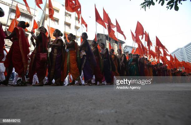 Traditionally dressed Indians march during the celebrations of the Gudi Padwa Maharashtrian's New Year in Mumbai India on March 28 2017 Gudi Padwa is...