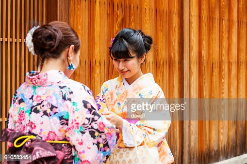Traditionally dressed japanese women in kimonos greet each other traditionally dressed japanese women in kimonos greet each other stock photo getty images m4hsunfo