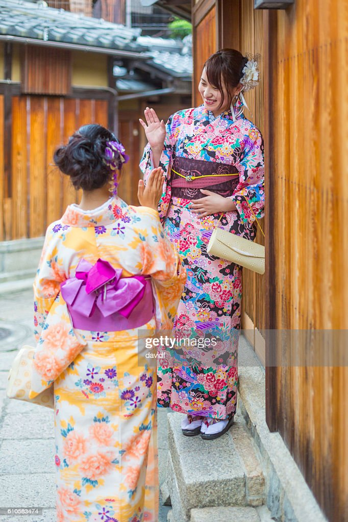 Traditionally dressed japanese women in kimonos greet each other traditionally dressed japanese women in kimonos greet each other stock photo m4hsunfo