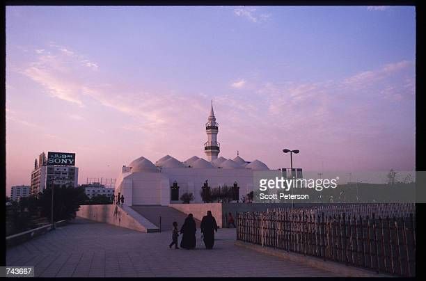 Traditionally dressed Saudis head towards the Jafaari Mosque July 15 1996 in Jeddah Saudi Arabia Possessing twentyfive percent of the world's oil...