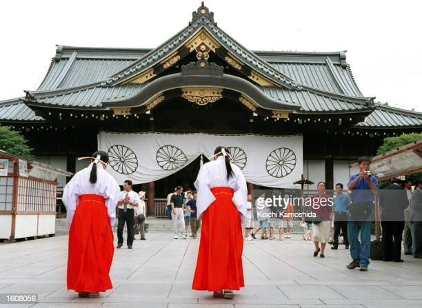 Traditionally dressed visitors pay their respects August 9 2001 at the Yasukuni Shrine in Tokyo Japan The Shinto shrine is dedicated to Japan''s war...