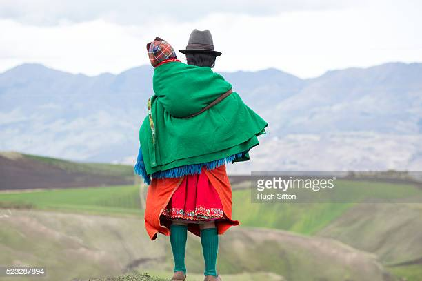 traditionally dressed woman carrying her child, ecuador - hugh sitton stock pictures, royalty-free photos & images