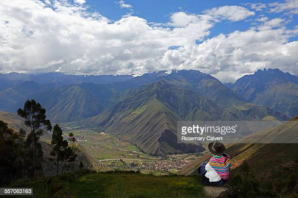 Traditionally dressed woman &view of Sacred Valley