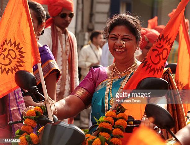 Traditionally dressed women taking part in procession on motorbikes at Girgaum on the occasion of Gudi Padwa, Marathi New year on April 11, 2013 in...