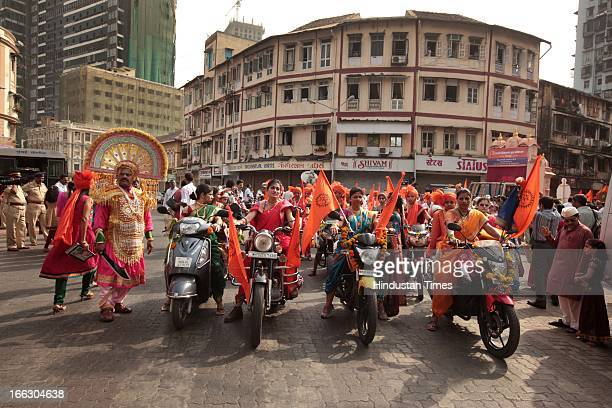 Traditionally dressed women taking part in procession on motorbikes at Girgaum on the occasion of Gudi Padwa Marathi New year on April 11 2013 in...