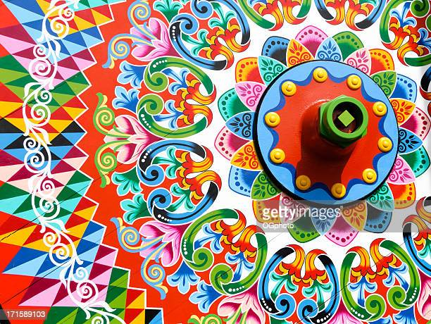 traditionally painted ox cart wheel - costa rica stock photos and pictures