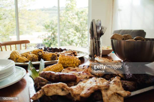 traditionally prepared latin american bbq food - cali colombia stock pictures, royalty-free photos & images