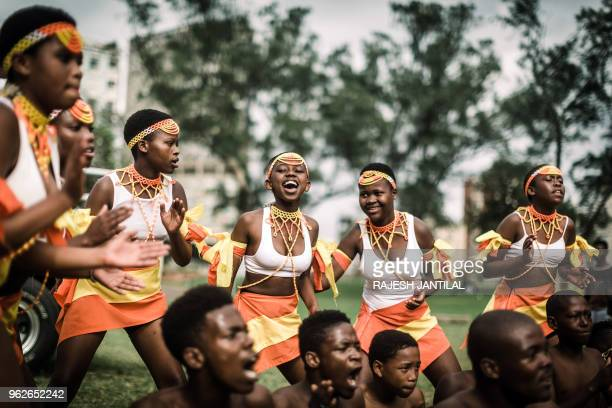 Traditionallyclad Zulu dancers take part on May 26 2018 in a street carnival festival in Durban celebrating Africa Month a month that sees Africans...