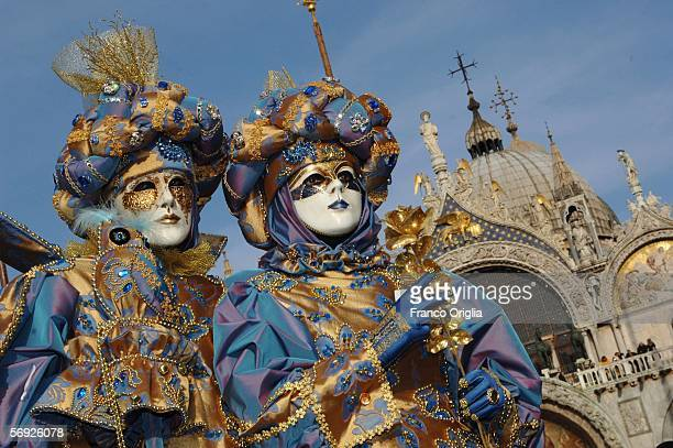Traditionaly masked Venetians pose on San Marco square during the Carnival February 23 2006 in Venice Italy The Carnival traditionally celebrates the...