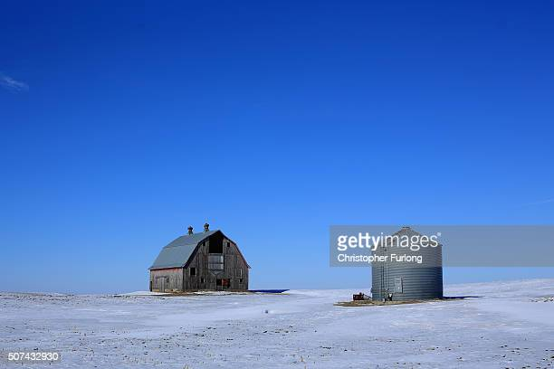 A traditionl barn adorns the snow covered vast grand plains of Iowa on January 29 2016 in Carrol County Iowa Candidates who are seeking the...