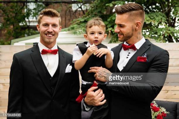 """traditionnal portrait of millenial groom with son and best man before wedding. - """"martine doucet"""" or martinedoucet stock pictures, royalty-free photos & images"""