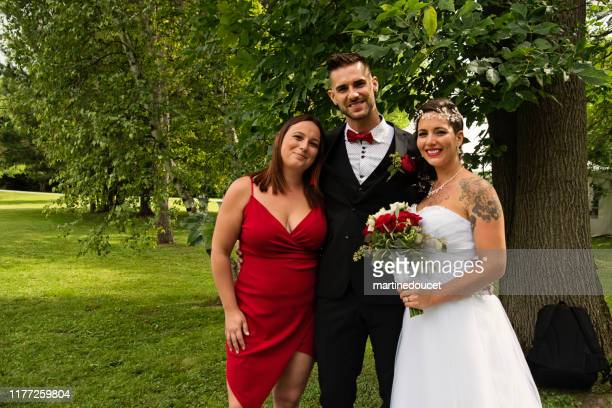 traditionnal wedding portrait of millennial couple outdoors. - bridesmaid stock pictures, royalty-free photos & images