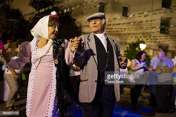 A tradtiional 'chulapos' couple dance in the historic La Latina neighbourhood during 'Las Fiestas de la Paloma' celebrations on August 14 2015 in...
