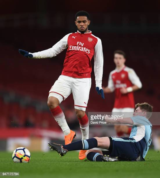 Trae Coyle of Arsenal is challenged by Brendan O'Brien of Blackpool during the match between Arsenal and Blackpool at Emirates Stadium on April 16...