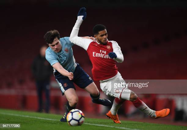 Trae Coyle of Arsenal is challenged by Tom Williams of Blackpool during the match between Arsenal and Blackpool at Emirates Stadium on April 16 2018...