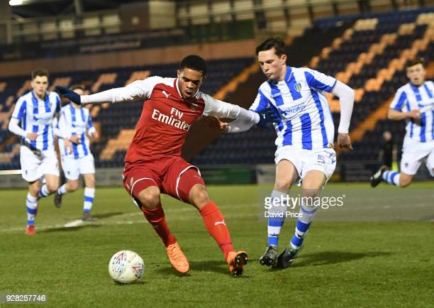 Trae Coyle of Arsenal is closed down by Billy Cracknell of Colchester during the FA Youth Cup match between Colchester United and Arsenal at Weston...