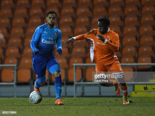 Trae Coyle of Arsenal takes on Nana Adarkwa of Blackpool during the match between Blackpool and Arsenal at Bloomfield Road on March 20 2018 in...