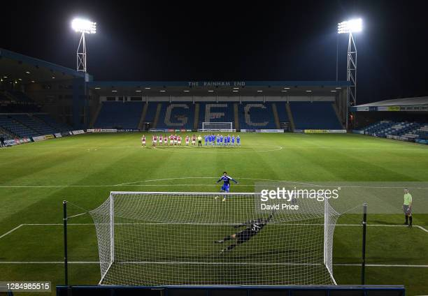 Trae Coyle of Gillingham scores from the penalty spot during the post match penalty shoot out during the match between Gillingham and Arsenal U21 at...