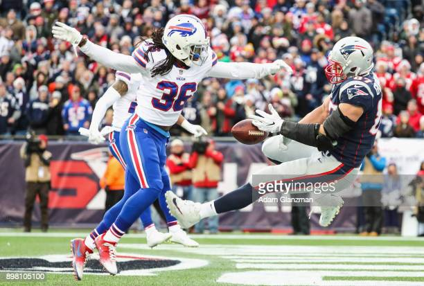 Trae Elston of the Buffalo Bills is called for pass interference as he defends Rob Gronkowski of the New England Patriots during the third quarter of...