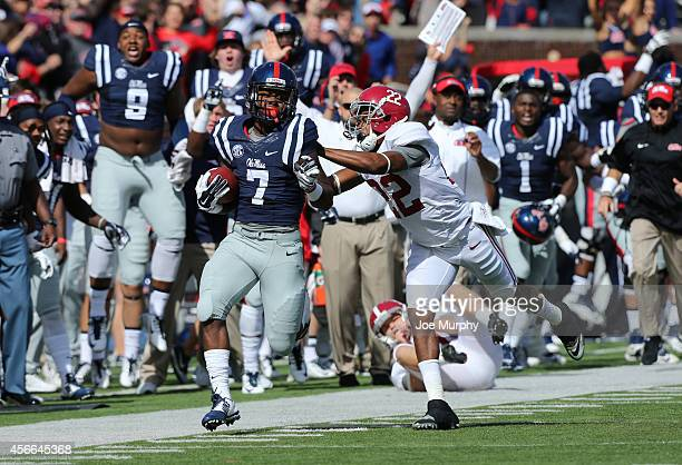 Trae Elston of the Ole Miss Rebels runs back the opening kick against Christion Jones of the Alabama Crimson Tide on October 4 2014 at...