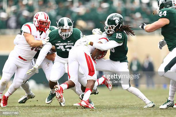 Trae Waynes of the Michigan State Spartans looks to tackle Robert Martin of the Rutgers Scarlet Knights at Spartan Stadium on November 22 2014 in...