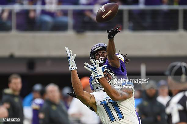 Trae Waynes of the Minnesota Vikings bats the ball away from Marvin Jones of the Detroit Lions during the fourth quarter of the game on November 6,...