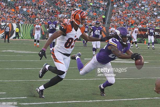 Trae Waynes of the Minnesota Vikings battles for the football with Tyler Boyd of the Cincinnati Bengals during their game at Paul Brown Stadium on...