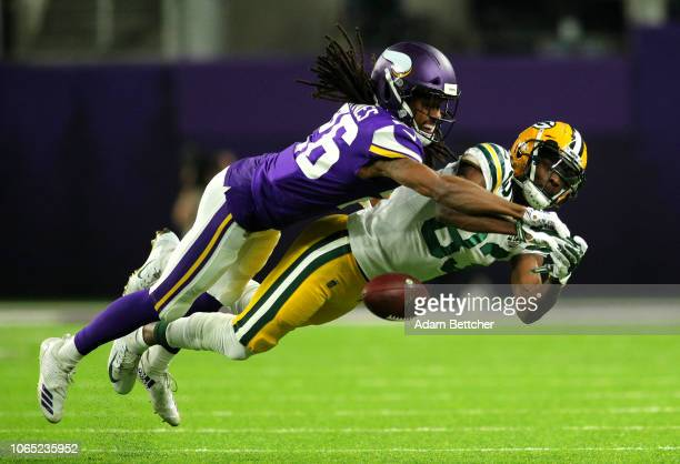 Trae Waynes of the Minnesota Vikings breaks up a pass to Marquez Valdes-Scantling of the Green Bay Packers in the first quarter of the game at U.S....