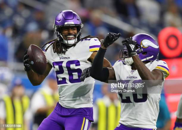 Trae Waynes of the Minnesota Vikings celebrates his fourth quarter interception with Mackensie Alexander while playing the Detroit Lions at Ford...