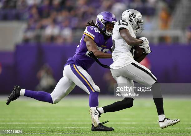 Trae Waynes of the Minnesota Vikings defends against J.J. Nelson of the Oakland Raiders during the second quarter of the game at U.S. Bank Stadium on...