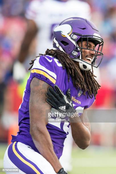 Trae Waynes of the Minnesota Vikings grabs his shoulder as he gets up during the first quarter of a preseason game against the Buffalo Bills on...