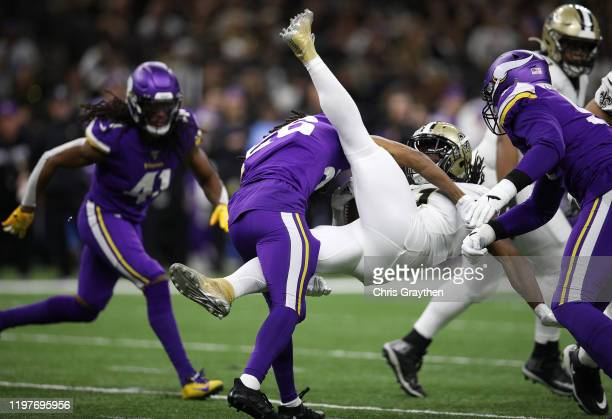 Trae Waynes of the Minnesota Vikings tackles Alvin Kamara of the New Orleans Saints during the first half in the NFC Wild Card Playoff game at...