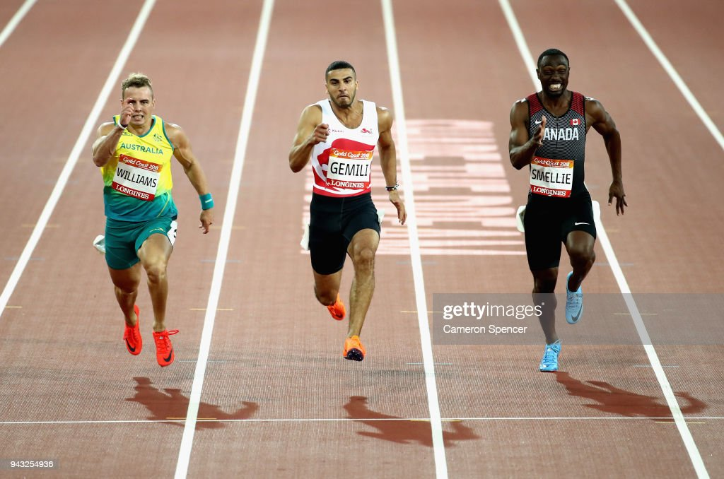 Trae Williams of Australia, Adam Gemili of England and Gavin Smellie of Canada compete in the Men's 100 metres semi finals on day four of the Gold Coast 2018 Commonwealth Games at Carrara Stadium on April 8, 2018 on the Gold Coast, Australia.