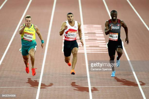 Trae Williams of Australia Adam Gemili of England and Gavin Smellie of Canada compete in the Men's 100 metres semi finals on day four of the Gold...