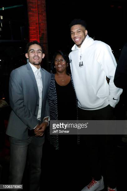 Trae Young and Giannis Antetokounmpo attend the Octagon AllStar Party at Theater on the Lake on February 14 2020 in Chicago Illinois