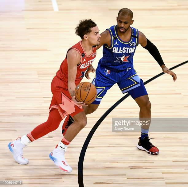 Trae Young of Team Giannis dribbles the ball while being guarded by Chris Paul of Team LeBron in the fourth quarter during the 69th NBA AllStar Game...