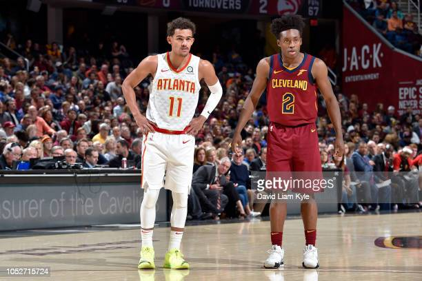 Trae Young of the Atlanta Hawks and Collin Sexton of the Cleveland Cavaliers look on during the game on October 21 2018 at Quicken Loans Arena in...