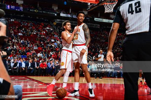 Trae Young of the Atlanta Hawks and John Collins of the Atlanta Hawks seen on court during the game against the Houston Rockets on February 25 2019...