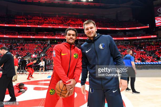 Trae Young of the Atlanta Hawks and Luka Doncic of the Dallas Mavericks pose for a photo before the game on October 24 2018 at State Farm Arena in...