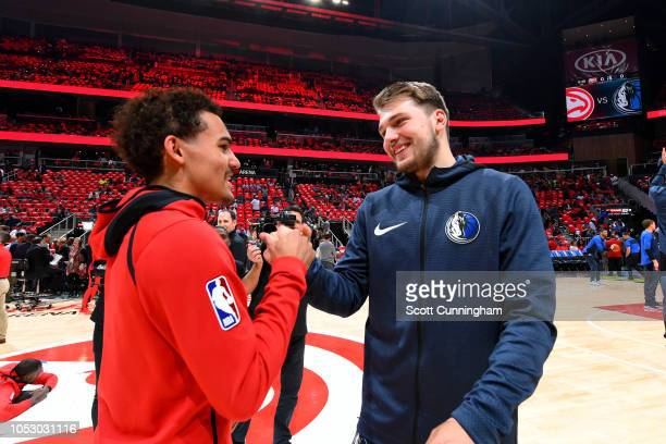 Trae Young of the Atlanta Hawks and Luka Doncic of the Dallas Mavericks talk before the game on October 24 2018 at State Farm Arena in Atlanta...