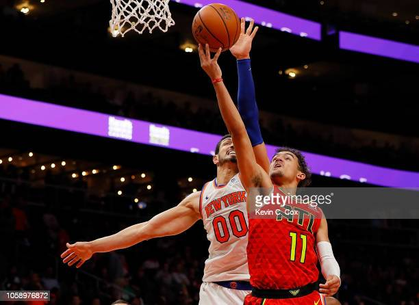 Trae Young of the Atlanta Hawks attacks the basket against Enes Kanter of the New York Knicks at State Farm Arena on November 7 2018 in Atlanta...